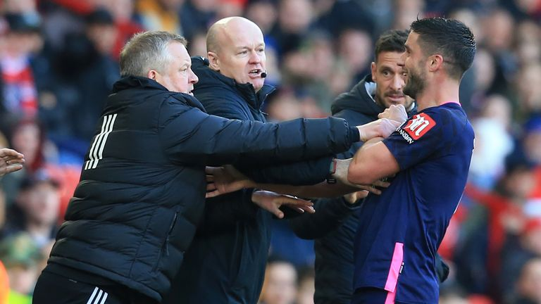 Chris Wilder and Andrew Surman exchange shoves on the touchline