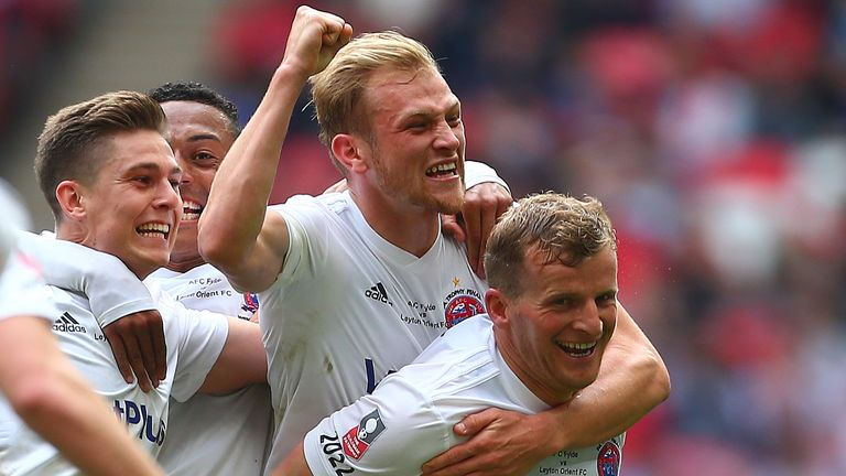Rowe celebrates with team-mates after scoring in the FA Trophy final