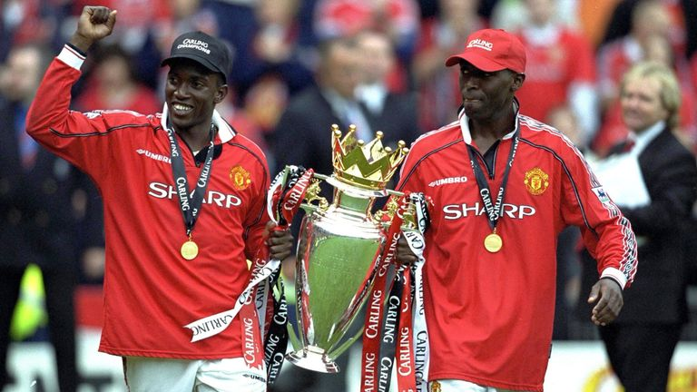 Dwight Yorke and Andy Cole celebrate Man Utd's Premiership title in 1999