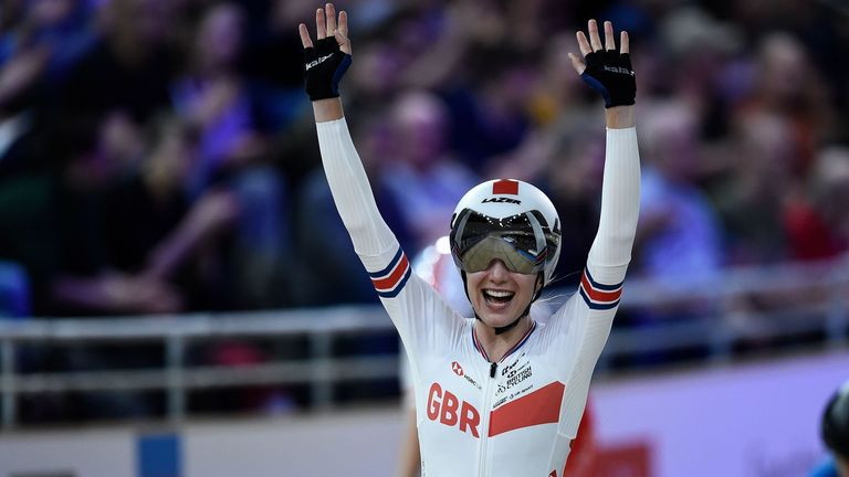 Barker celebrates after winning the women's 25km points final at the UCI track cycling World Championship