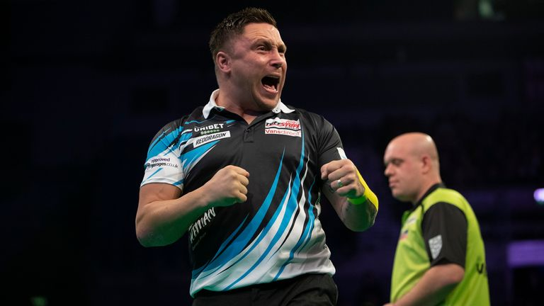 Gerwyn Price celebrates winning a leg against Michael van Gerwen