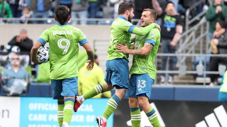 Jordan Morris (R) celebrates his goal with Joao Paulo