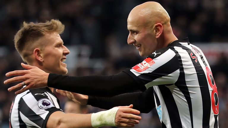 Shelvey celebrates with Newcastle team-mate Matt Ritchie
