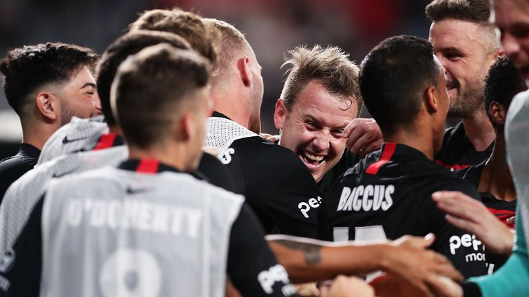 Cox celebrates after scoring for Western Sydney Wanderers