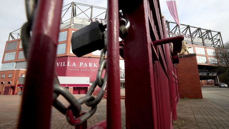 A view of locked gates at Villa Park with the suspension on football extended