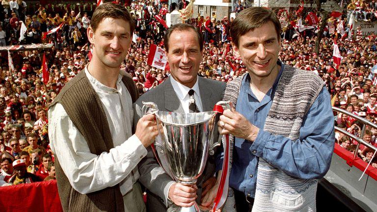 Adams (left) was a key figure in four title-winning Arsenal teams