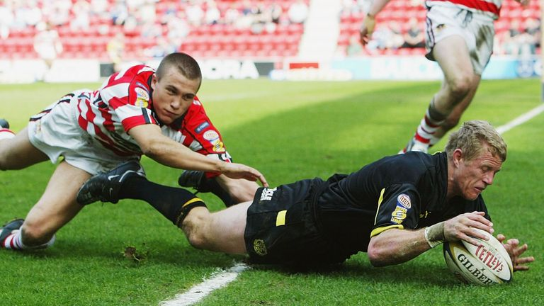 Darren Albert beat Jon Whittle to score one of his two tries for St Helens