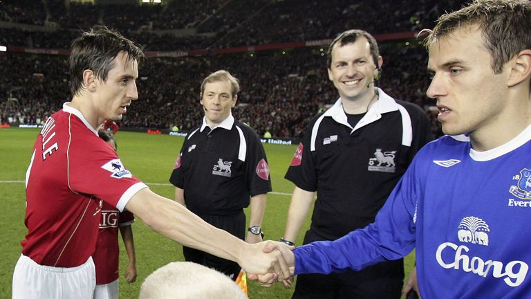 Gary and Phil Neville as captains of Manchester United and Everton