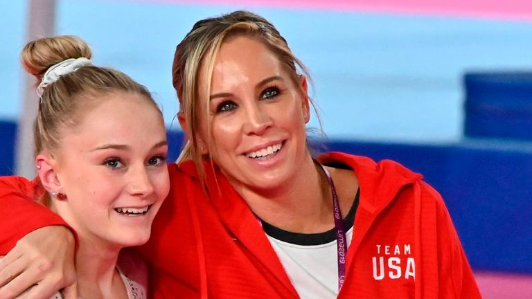 Maggie Haney (C)) coached many top gymnasts including 2018 world champion Riley McCusker (L)