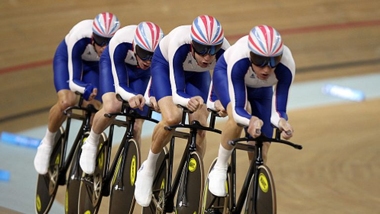 Paul Manning, Ed Clancy, Geraint Thomas and Sir Bradley Wiggins on their way to winning the Men's Team Pursuit Finals at the Beijing 2008 Olympic Games