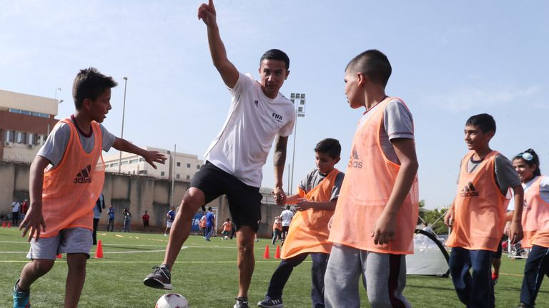 Cahill coaches Lebanese school children in southern Beirut last year