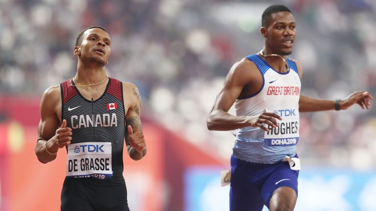 Andre De Grasse of Canada and Zharnel Hughes of Great Britain compete in Doha