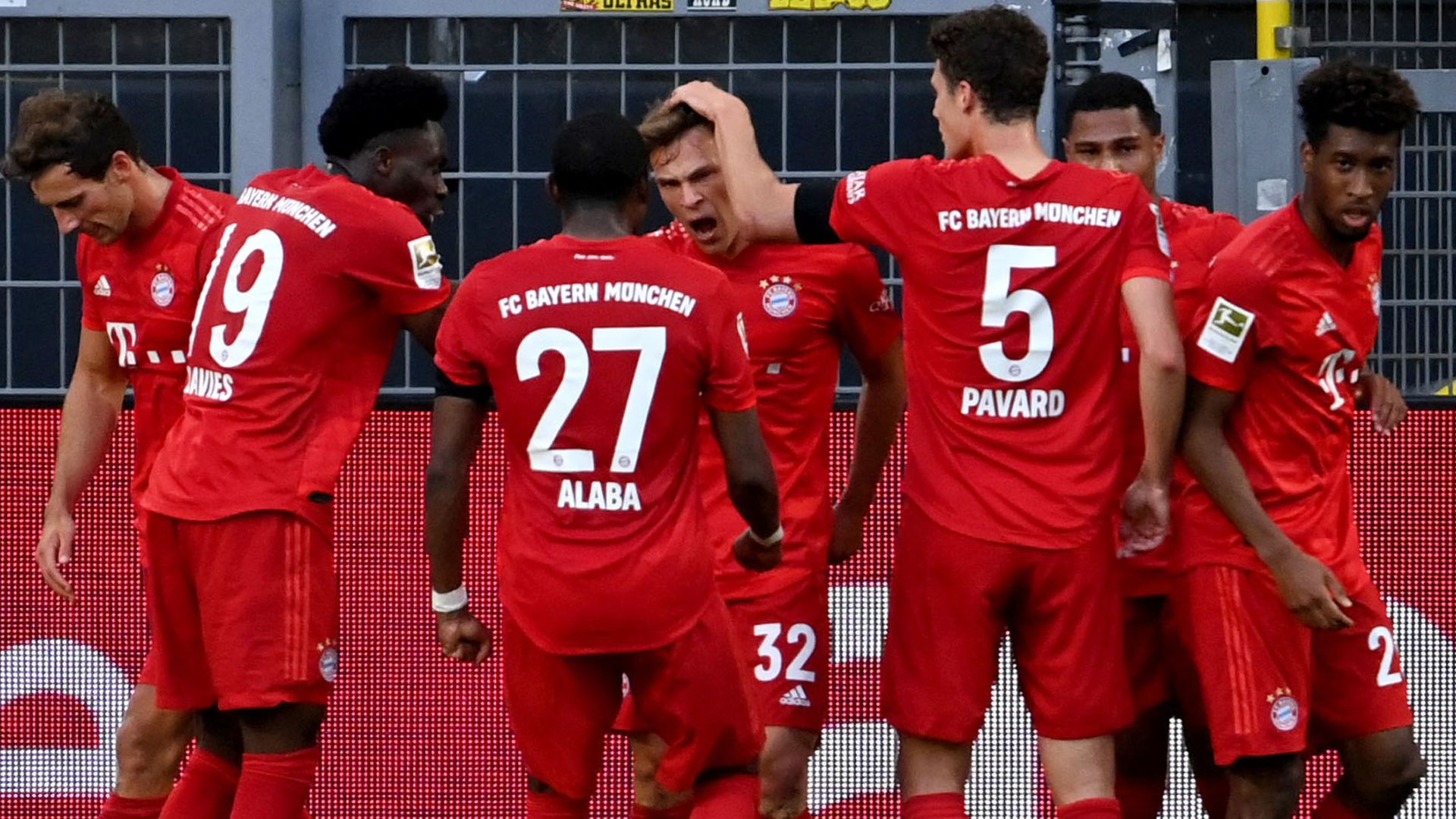 Bayern go seven points clear with win at Dortmund