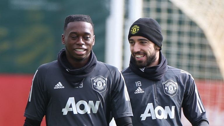 Aaron Wan-Bissaka and Bruno Fernandes of Manchester United in action during a first-team training session