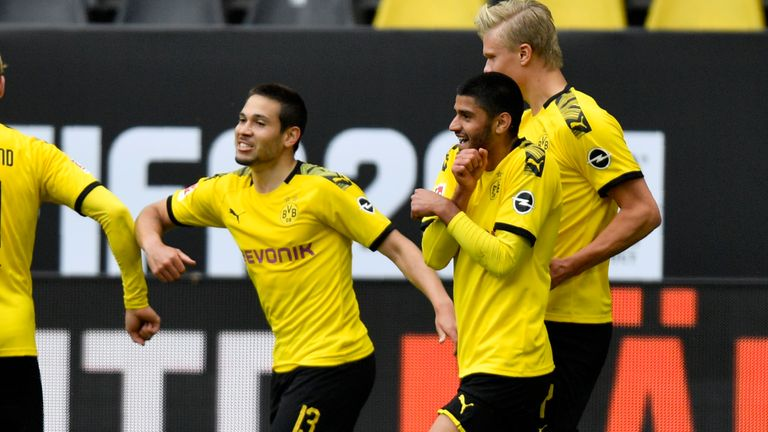 Raphael Guerreiro celebrates with team-mates after scoring Dortmund's second just before half-time