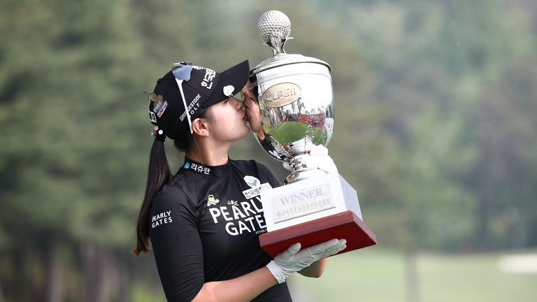 Hyun Kyung Park kissing the KLPGA Championship trophy after her victory