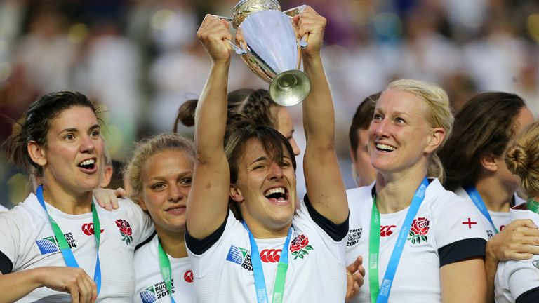 Daley-Mclean lifts the 2014 Women's Rugby World Cup trophy
