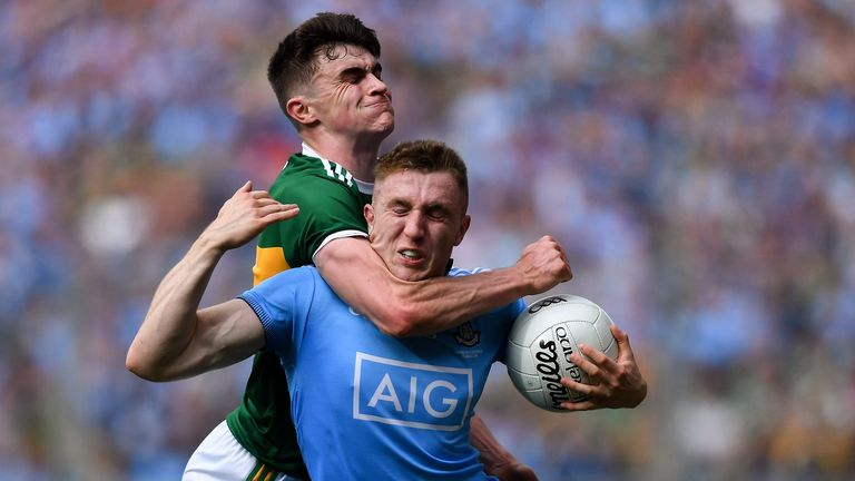 Paddy Small of Dublin is fouled by Seán O'Shea of Kerry, late in the 2019 drawn All-Ireland Football Championship final