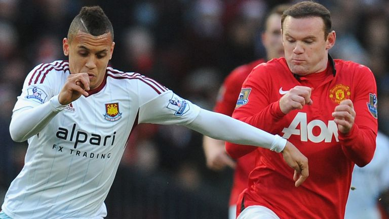 Wayne Rooney challenges Morrison during the former United youngster's spell at West Ham