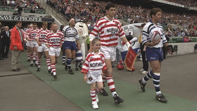 Wigan captain Andy Farrell and Bath skipper Phil de Glanville lead their teams out at Twickenham in the second game of the series in May 1996