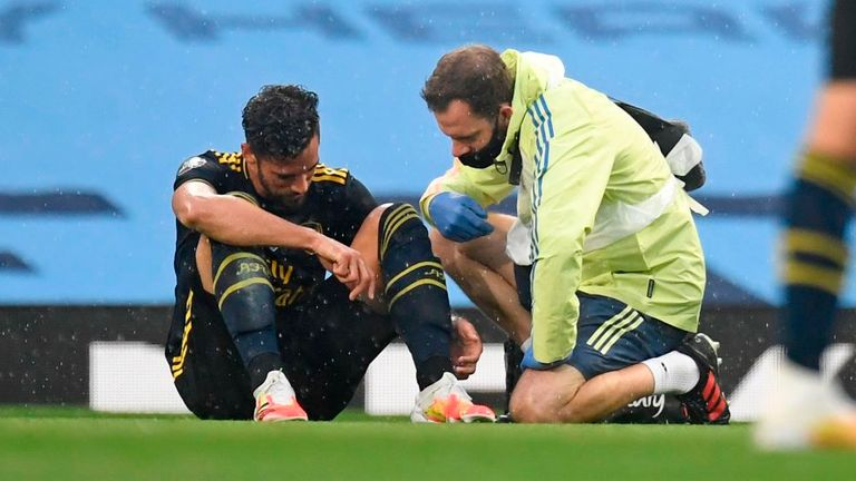 Arsenal defender Pablo Mari receives treatment after being injured against Manchester City