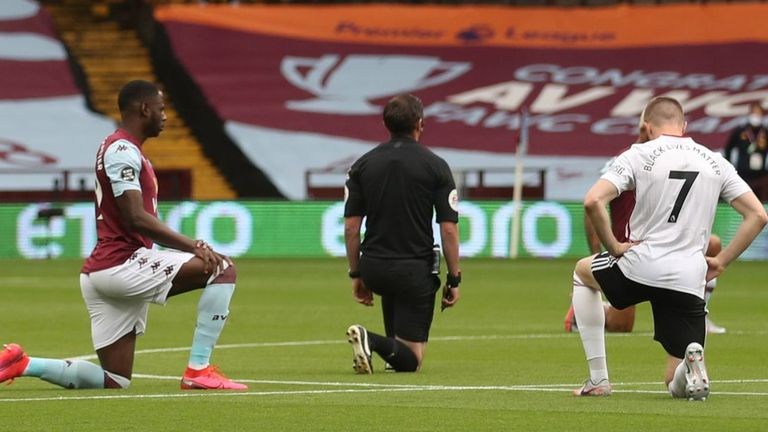 Referee Michael Oliver joined Aston Villa and Sheffield United players in taking a knee before kick-off at Villa Park