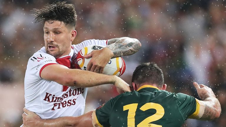 England's Gareth Widdop is tackled by Matt Gillett of Australia during the 2017 Rugby League World Cup final