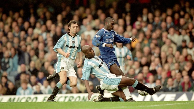 Williams in action for Coventry as he tackles Jimmy Floyd Hasselbaink