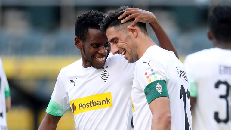 Borussia Monchengladbach's Ibrahima Traore and Lars Stindl celebrate