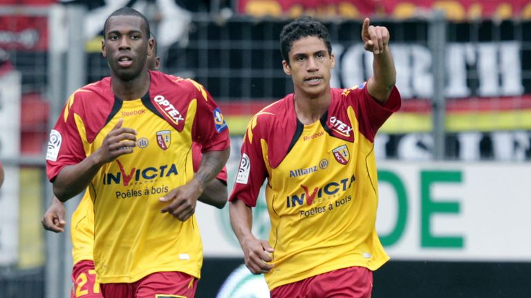 Raphael Varane (right) was being tracked by Arsenal at Lens, before his big-money move to Real Madrid