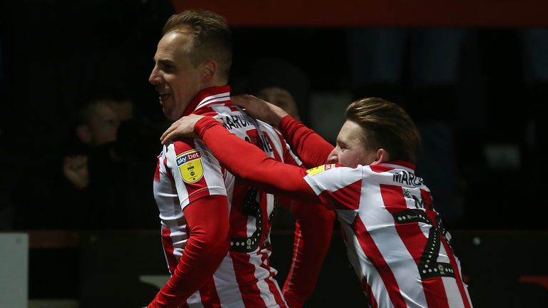 Varney celebrates with team-mate Alfie May after scoring his side's second goal during the match between Cheltenham Town and Northampton Town