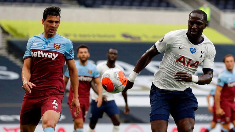 Moussa Sissoko vies with West Ham's Fabian Balbuena