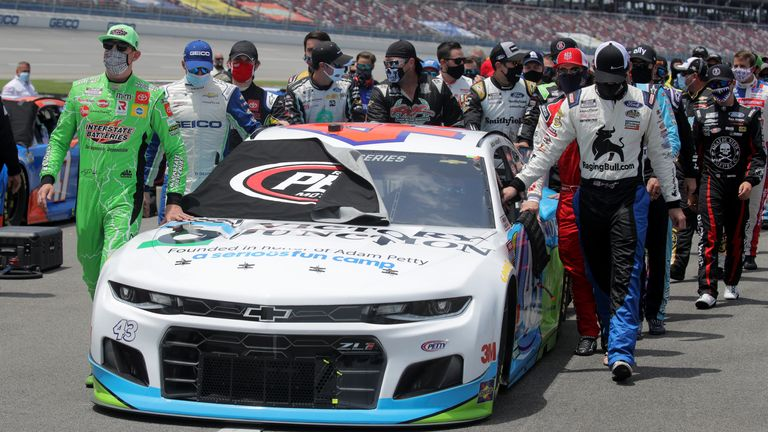 NASCAR drivers push Bubba Wallace's car to the front of the grid in a sign of solidarity with him