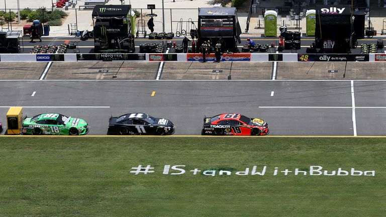 An #IStandWithBubba message has appeared on the grass before a NASCAR race at Talladega Superspeedway in Lincoln, Alabama