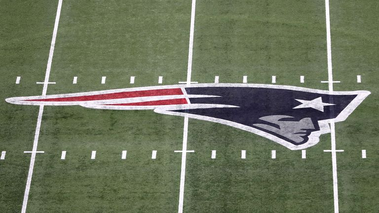 National Football League  fines Patriots, takes away draft pick for sideline filming