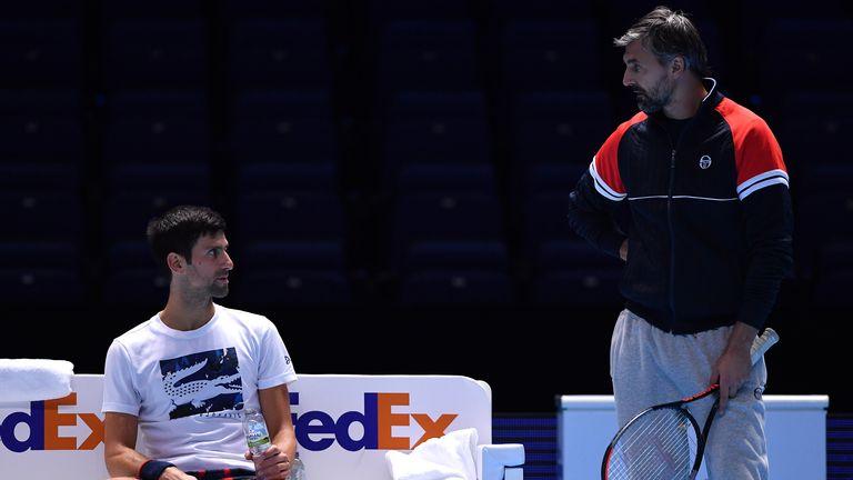 Novak Djokovic talks to coach Goran Ivanisevic