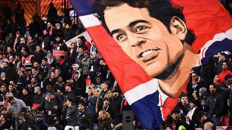 Paris Saint-Germain supporters celebrate their former hero, Rai