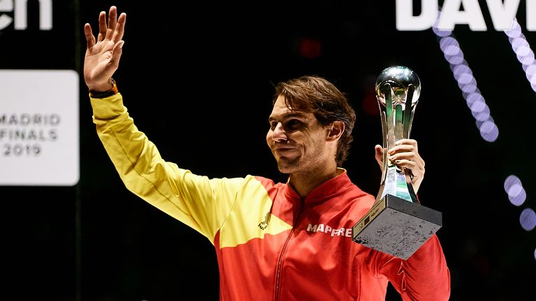 Rafael Nadal holds the best player trophy after Team Spain's victory in last year's Davis Cup in Madrid