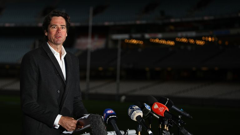 AFL chief executive Gillon McLachlan says the league will set-up a 'transition hub' to allow players' families to join them in Queensland
