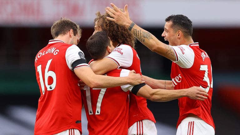 Cedric is mobbed by team-mates after scoring against Norwich