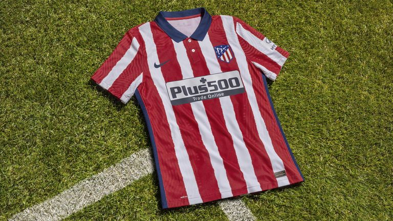 Atletico Madrid's home kit features traditional red and white stripes with a twist