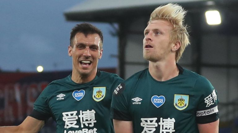 Ben Mee (right) celebrates after scoring Burnley's winner at Crystal Palace in June