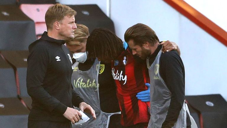 Bournemouth defender Nathan Ake is helped off the pitch after he was injured against Leicester