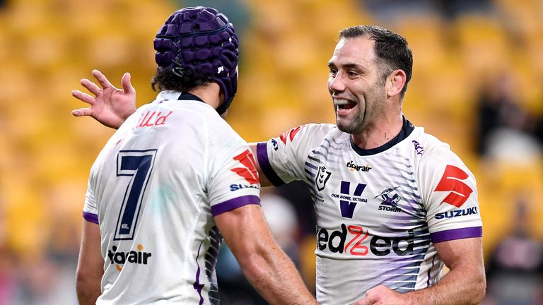Cameron Smith and Jahrome Hughes celebrate during Melbourne's win over Brisbane