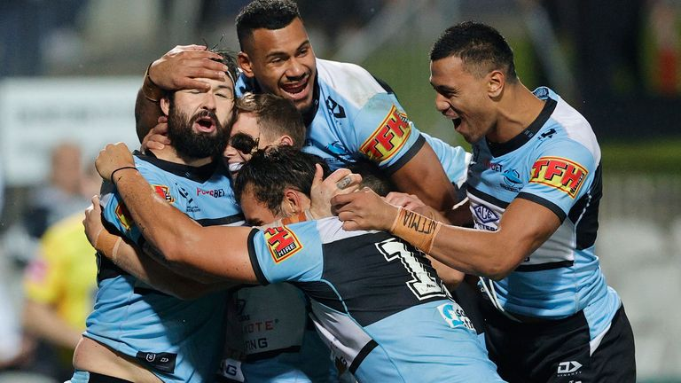 Cronulla's players celebrate a try during the win over St George