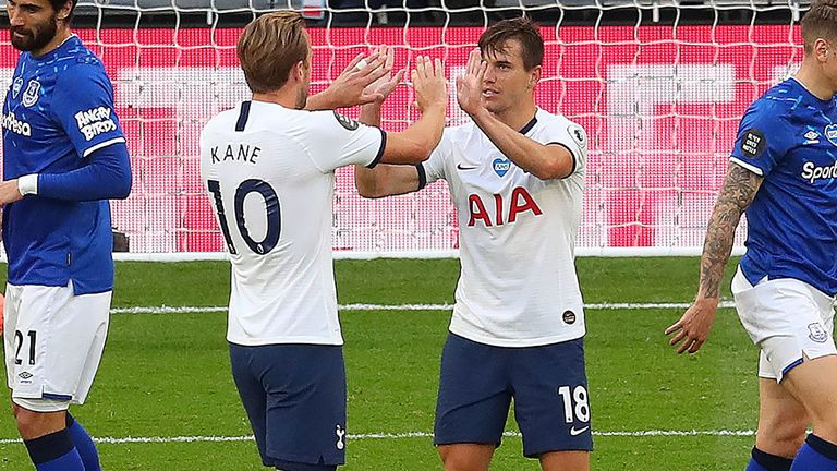 Giovani Lo Celso celebrates with Harry Kane after his shot deflected in off Michael Keane for the Tottenham opener