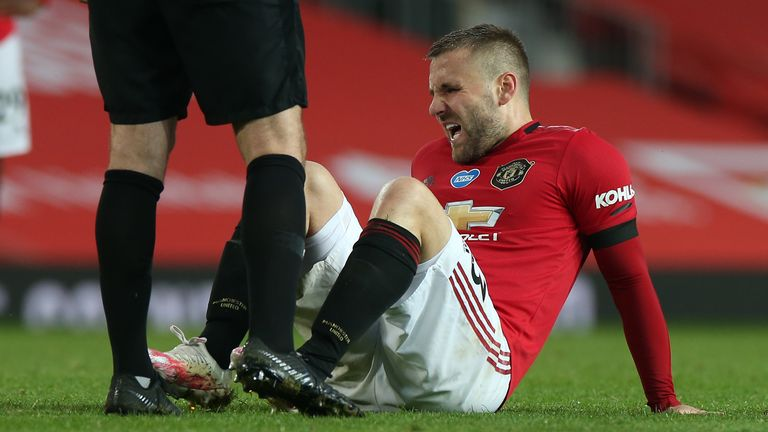 Luke Shaw winces after rolling his right ankle against Southampton