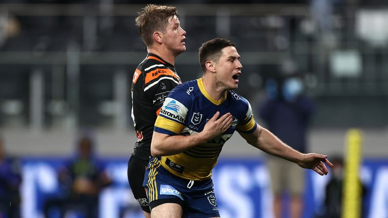 Mitchell Moses celebrates scoring for the Eels