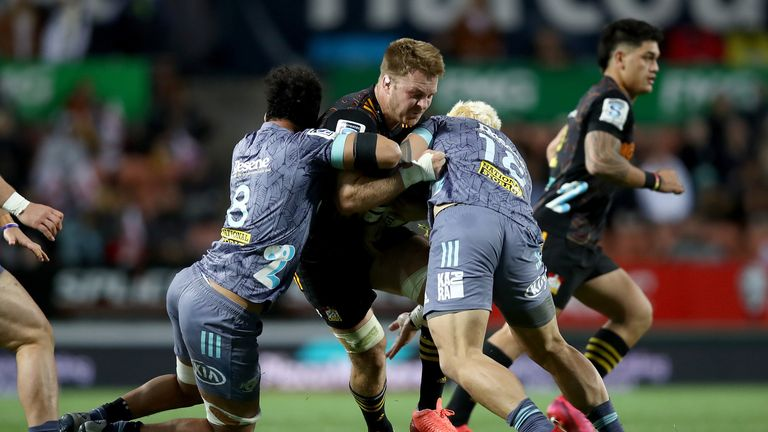 Sam Cane takes on the Chiefs defence