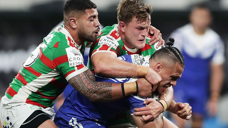 Sauaso Sue is wrapped up by the Rabbitohs defence
